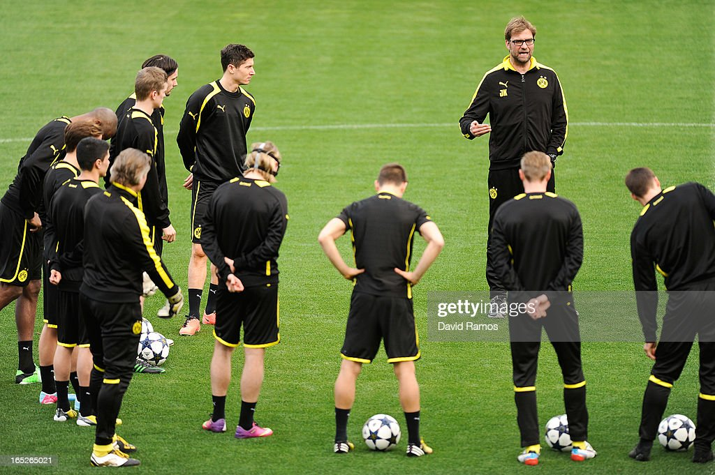 Coach Jurgen Klopp of Borussia Dortmund speaks to his players during training session ahead of the UEFA Champions League quarter-final first leg match against Malaga CF, at La Rosaleda Stadium on April 2, 2013 in Malaga, Spain.
