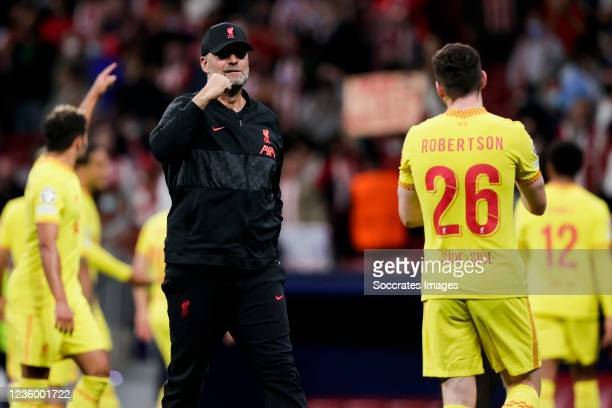 Coach Jurgen Klopp of Liverpool FC, Andy Robertson of Liverpool FC celebrate the victory during the UEFA Champions League match between Atletico...