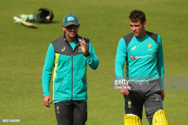 Coach Justin Langer and Alex Carey talk during an Australian ODI training session at Allan Border Field on May 28 2018 in Brisbane Australia