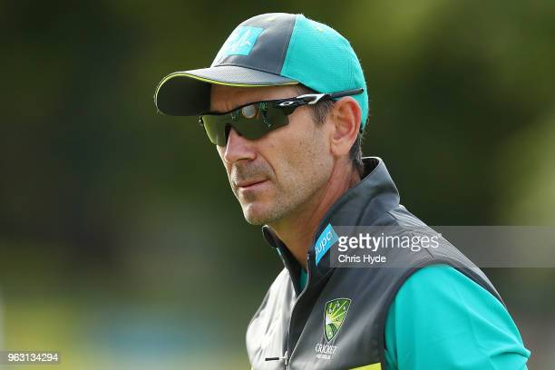 Coach Justin Langer looks on during an Australian ODI training session at Allan Border Field on May 28 2018 in Brisbane Australia