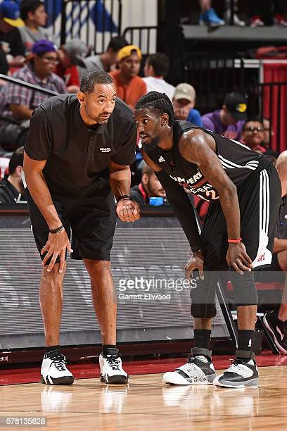 Coach Juwan Howard of the Miami Heat talks with Briante Weber of the Miami Heat during the game against the Phoenix Suns during the 2016 NBA Las...