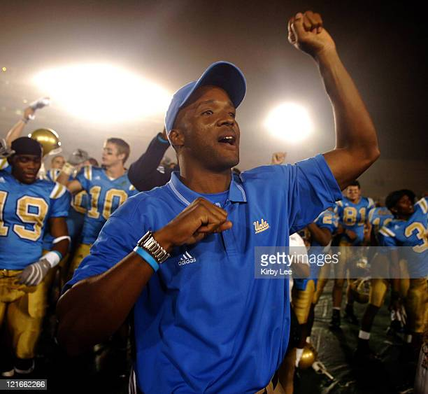 Coach Karl Dorrell celebrates 51-28 victory over Oregon State in Pacific-10 Conference football game at the Rose Bowl in Pasadena, Calif. On...