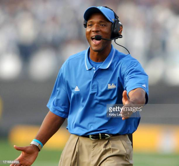 Coach Karl Dorrell celebrates a touchdown during 51-28 victory over Oregon State in Pacific-10 Conference football game at the Rose Bowl in Pasadena,...