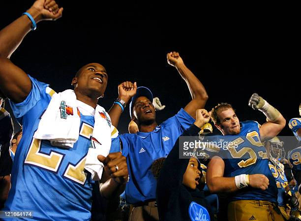 UCLA coach Karl Dorrell celebrates with Aaron Ware Mike McCloskey and his daughter Lauren Dorrell after 2117 victory over Washington in a Pacific10...