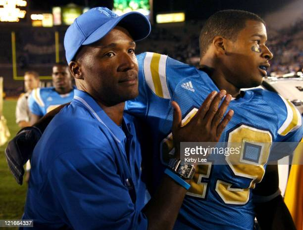 UCLA coach Karl Dorrell embraces linebacker Fred Holmes after 2117 victory over Washington in a Pacific10 Conference game at the Rose Bowl in...