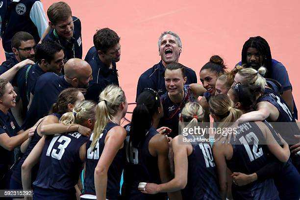 Coach Karsh Kiraly and Team USA celebrate match point during the Women's Bronze Medal Match between Netherlands and the United States on Day 15 of...