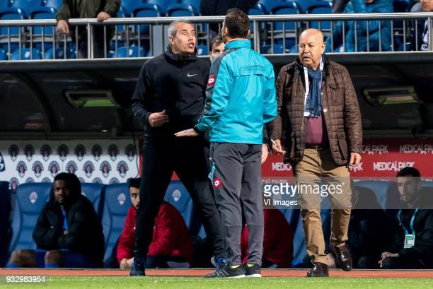 coach Kemal Özdes of Kasimpasa AS in discussion with the fourth official Bahattin Simsek during the Turkish Spor Toto Super Lig match between...