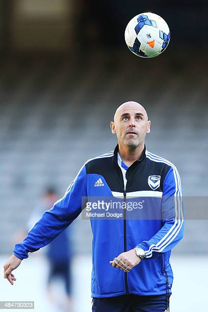 Coach Kevin Muscat looks at the ball during a Melbourne Victory ALeague training session at Etihad Stadium on April 14 2014 in Melbourne Australia