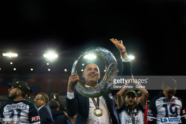 Coach Kevin Muscat of Melbourne Victory celebrates by holding up the ALeague trophy in front of fans after winning the 2018 ALeague Grand Final match...