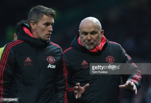 Coach Kieran McKenna and Coach Mike Phelan of Manchester United walks off at halftime during the Premier League match between Manchester United and...