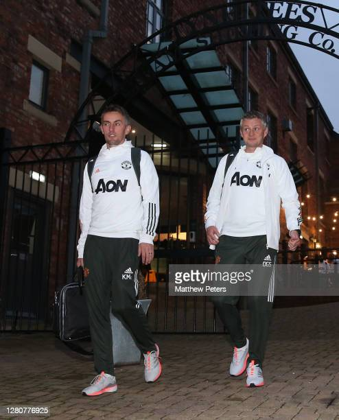 Coach Kieran McKenna and Manager Ole Gunnar Solskjaer of Manchester United leave the team hotel ahead of the Premier League match between Newcastle...