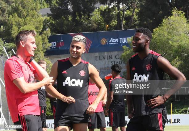 Coach Kieran McKenna Andreas Pereira and Timothy FosuMensah of Manchester United in action during a first team training session as part of their...