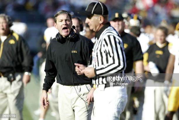 Coach Kirk Ferentz of the Iowa Hawkeyes yells towards an official against the Ohio State Buckeyes October 18 2003 at Ohio Stadium in Columbus Ohio