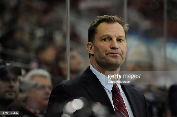 Coach Kirk Muller of the Carolina Hurricanes watches his team during a 21 loss to the Edmonton Oilers at PNC Arena on March 16 2014 in Raleigh North...
