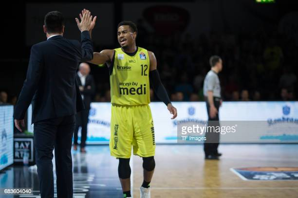 Coach Korner Raoul shakes hands with Lewis Trey of medi bayreuth during the easyCredit BBL match between medi bayreuth and EWE Baskets Oldenburg at...