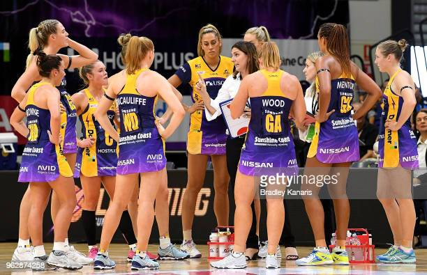 Coach Kyee Byrne of the Lightning talks to her players at the halftime break during the round five Super Netball match between the Lightning and the...