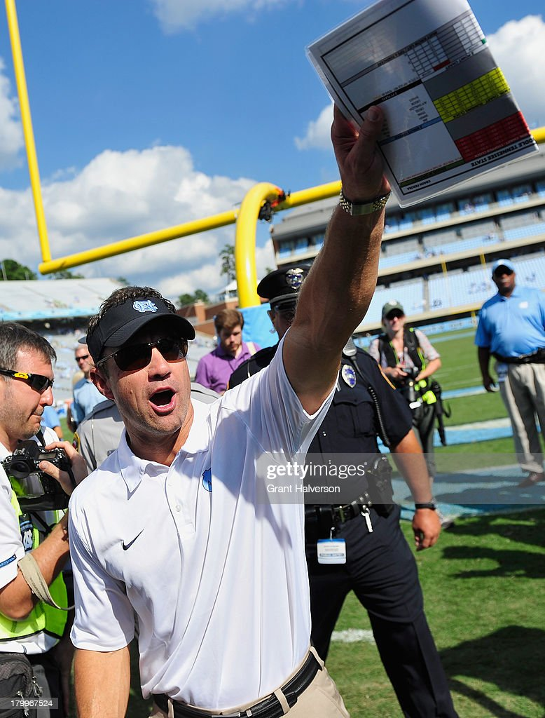 Coach Larry Fedora of the North Carolina Tar Heels waves to the fans after a win against the Middle Tennessee State Blue Raiders at Kenan Stadium on September 7, 2013 in Chapel Hill, North Carolina.