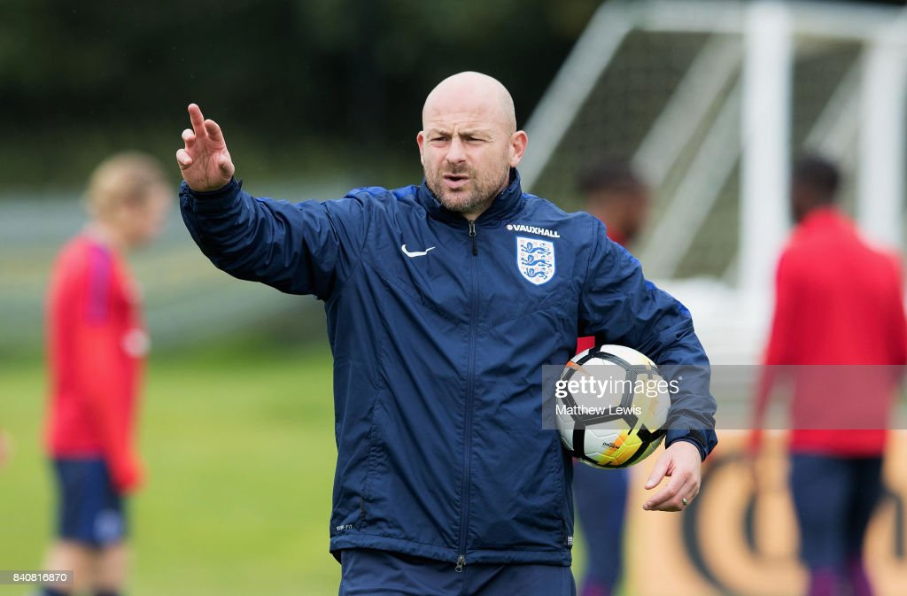 Coach Lee Carsley gives instructions during an England Under 21 training session at St George's Park on August 30, 2017 in Burton-upon-Trent, England.