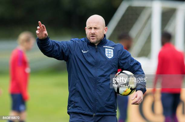 Coach Lee Carsley gives instructions during an England Under 21 training session at St George's Park on August 30 2017 in BurtonuponTrent England