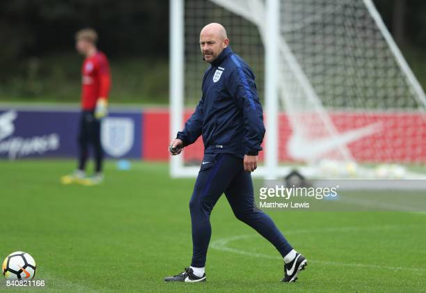 Coach Lee Carsley looks on during an England Under 21 training session at St George's Park on August 30 2017 in BurtonuponTrent England