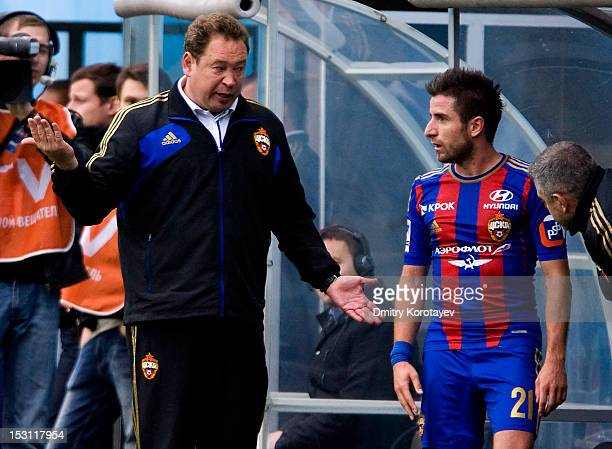 Coach Leonid Slutsky of PFC CSKA Moscow talks to Zoran Tosic during the Russian Premier League match between PFC CSKA Moscow and FC Dynamo Moscow at...