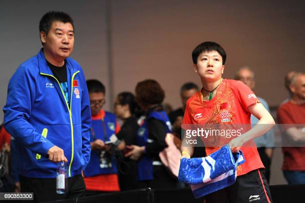Coach Li Sun of China directs China's player Mu Zi during women qualification on day 2 of 2017 World Table Tennis Championships at Messe Duesseldorf...