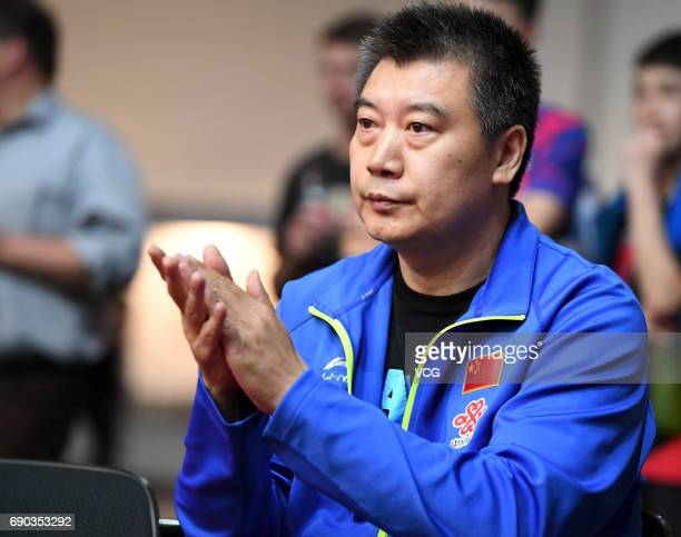 Coach Li Sun of China watches China's player Mu Zi during women qualification on day 2 of 2017 World Table Tennis Championships at Messe Duesseldorf...
