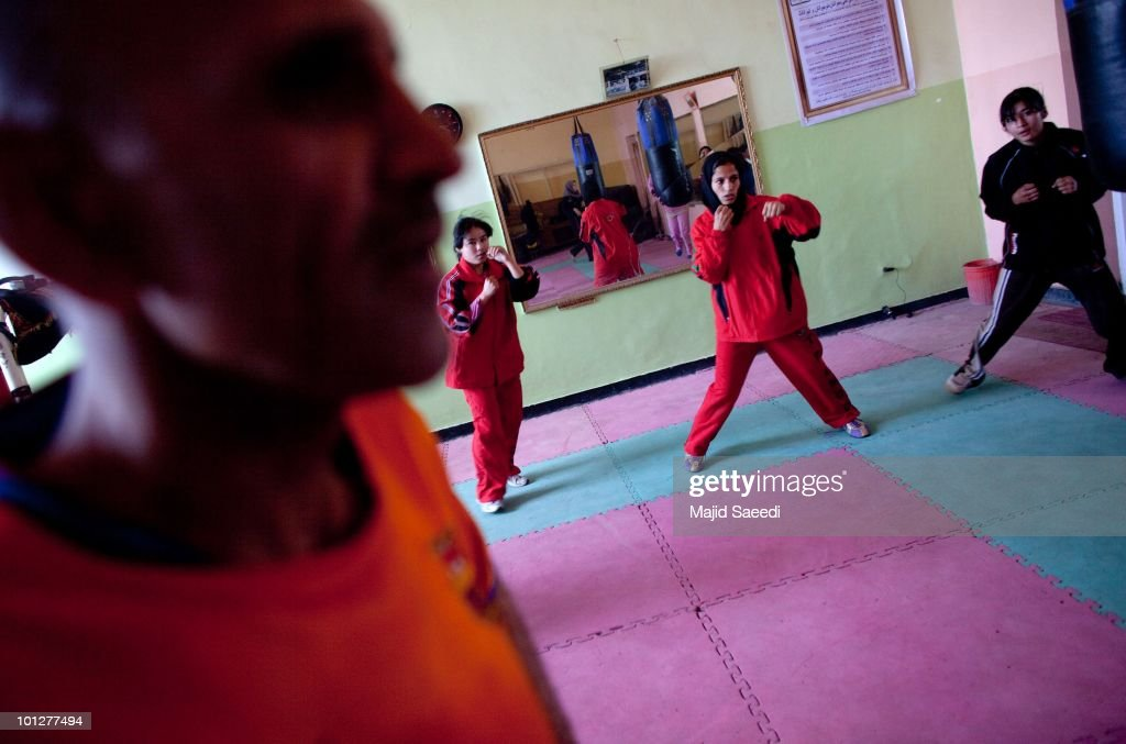 pashtun tribesmen and children living on the outskirts of kabul  a coach looks on as members of the women s national boxing team take part in