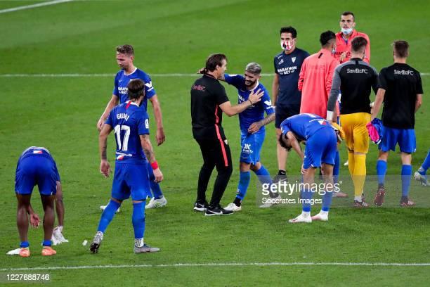 coach Lopetegui of Sevilla FC Ever Banega of Sevilla FC celebrates goal the victory during the La Liga Santander match between Athletic de Bilbao v...