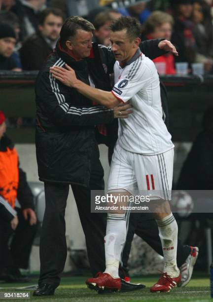 Coach Louis van Gaal congratulates Ivica Olic of Bayern Muenchen during the UEFA Champions League Group A match between FC Bayern Muenchen and...
