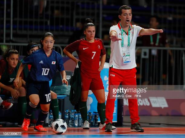 Coach Luis Conceicao of Portugal communicates to his team against Japan in the Women's Futsal Final match between Portugal and Japan during the...
