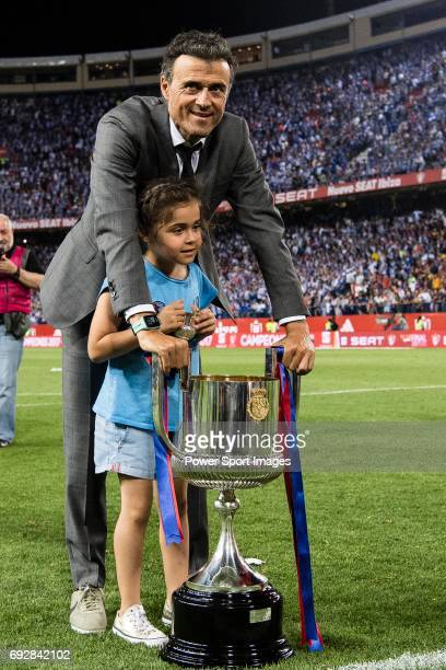 Coach Luis Enrique Martinez Garcia of FC Barcelona and his daughter poses for photos with the trophy after winning the Copa Del Rey Final between FC...