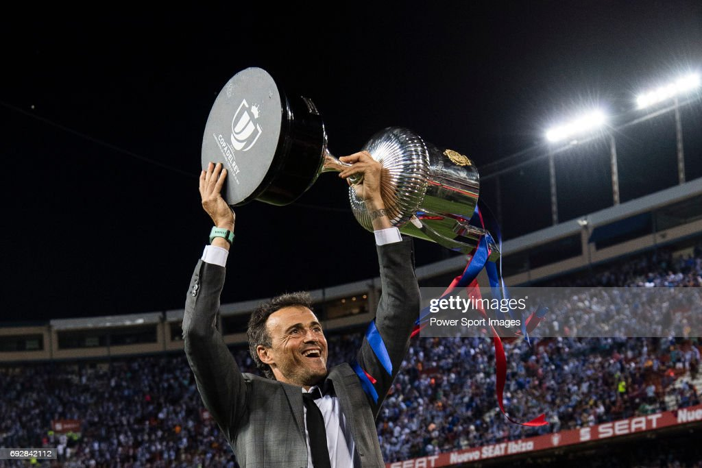 Coach Luis Enrique Martinez Garcia of FC Barcelona poses for photos with the trophy after winning the Copa Del Rey Final between FC Barcelona and Deportivo Alaves at Vicente Calderon Stadium on May 27, 2017 in Madrid, Spain.