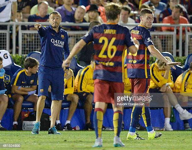 Coach Luis Inrique of FC Barcelona issues instructions to defender Thomas Vermaelen and midfielder Sergi Samper during the second half of their...