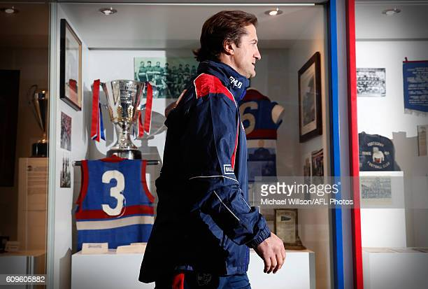 Coach Luke Beveridge walks past the Bulldogs 1954 premiership cup after speaking to the media during a Western Bulldogs AFL press conference at...