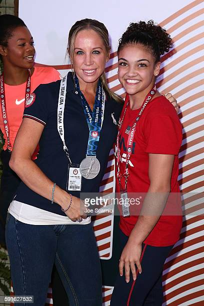 Coach Maggie Haney and US Olympian Laurie Hernandez pose for a photo during the Order of Ikkos Ceremony at the USA House at Colego Sao Paulo on...