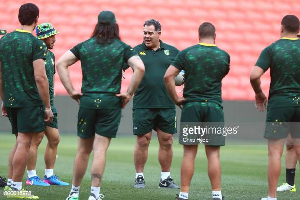 Coach Mal Meninga talks to players during an Australian Kangaroos Rugby League World Cup training session at Suncorp Stadium on October 11 2017 in...
