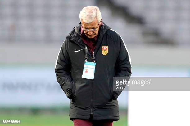 Coach Marcello Lippi of China attends a training session ahead of the 2017 EAFF E1 Football Championship Final round at Ajinomoto Stadium on December...