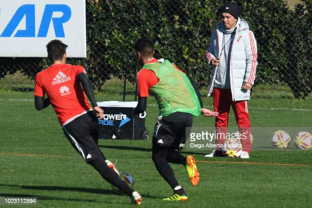 Gonzalo Martinez controls the ball as coach Marcelo Gallardo follows the actions during a River Plate training session at River Camp on August 21...