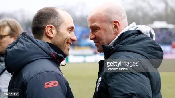 Coach Marco Antwerpen of Muenster talks to coach Steffen Baumgart of Paderborn before the 3 Liga match between SC Preussen Muenster and SC Paderborn...
