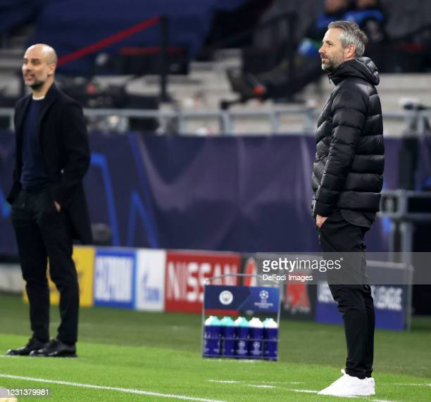 Coach Marco Rose of Borussia Moenchengladbach and Pep Guardiola of Manchester City looks on during the UEFA Champions League Round of 16 match...