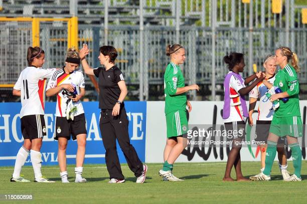 Coach Maren Meinert of Germany celebrates with her players after winning the UEFA European Women's U19 Championship match between Germany and Spain...