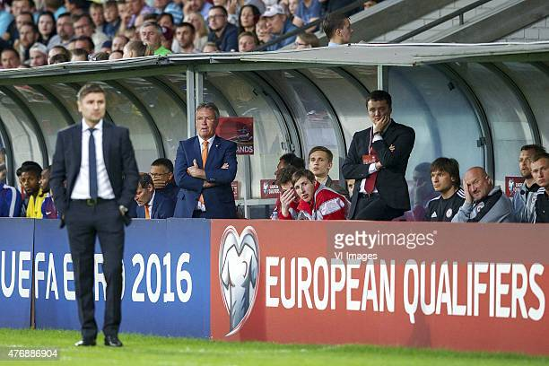 coach Marians Pahars of Latvia coach Guus Hiddink of Holland during the UEFA EURO 2016 qualifying match between Latvia and The Netherlands on June 12...