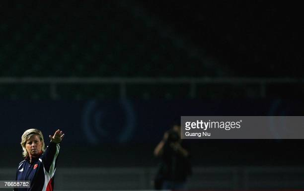Coach Marika Domanski-Lyfors instructs her players during a China training session for the FIFA 2007 World Cup in China at Wuhan Sports Center...