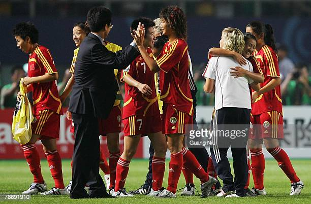 Coach Marika Domanski-Lyfors of China hugs her players after they won the match 3-2 against Denmark in the FIFA Women's World Cup 2007 Group D match...