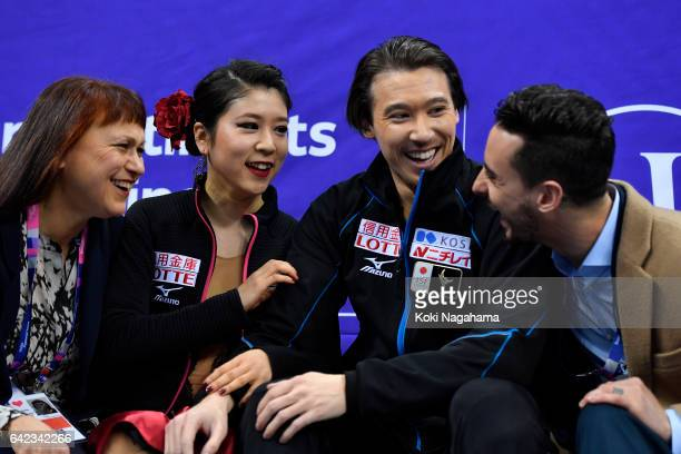 Coach Marina Zueva and Kana Muramoto and Chris Reed and Coach Massimo Scali in the kiss and cry after the Ice Dance Free Dance during ISU Four...