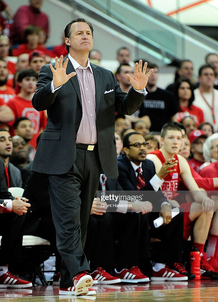 Coach Mark Gottfried of the North Carolina State Wolfpack tells his team to slow down the tempo during a win over the North Carolina Tar Heels at PNC Arena on January 26, 2013 in Raleigh, North Carolina. North Carolina State won 91-83.