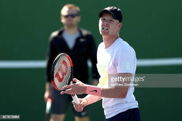 Coach Mark Hilton watches Kyle Edmund of Great Britain train in preparation for the BNP Paribas Open at the Indian Wells Tennis Garden on March 5,...