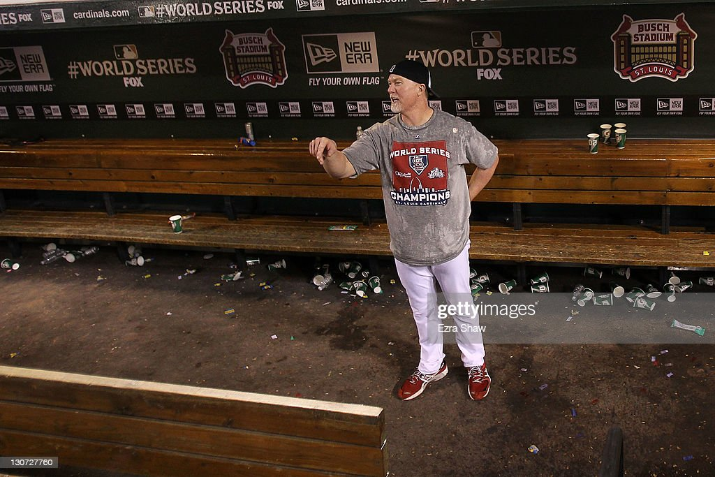Coach Mark McGuire of the St. Louis Cardinals celebrates after defeating the Texas Rangers 6-2 to win Game Seven of the MLB World Series at Busch Stadium on October 28, 2011 in St Louis, Missouri.