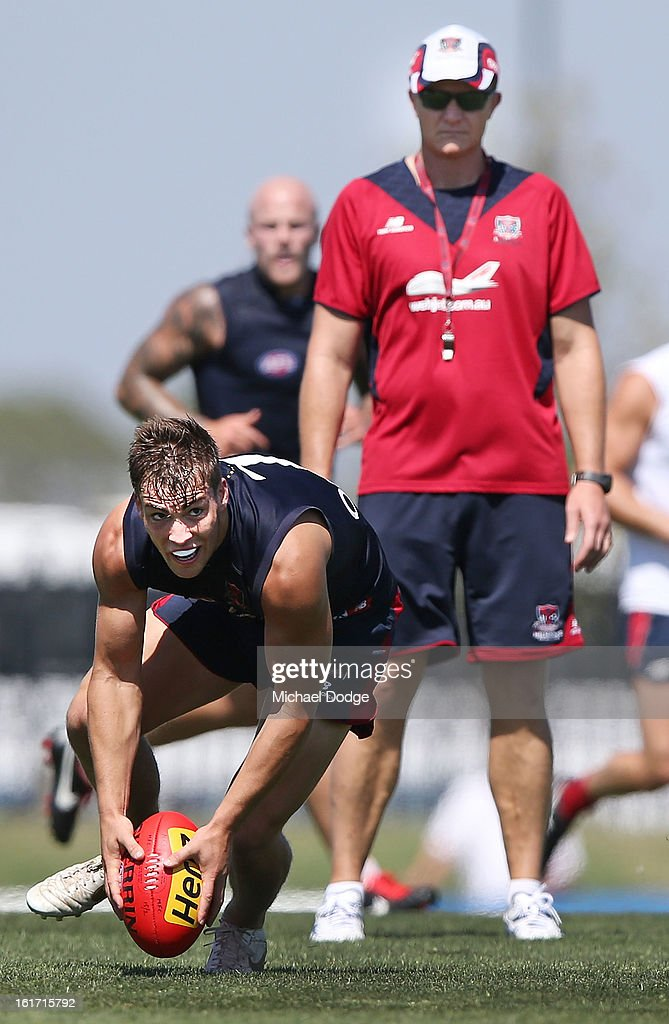 Coach Mark Neeld watches star draftee Jack Viney run with the ball during a Melbourne Demons intra-club match session session at Casey Fields on February 15, 2013 in Melbourne, Australia.